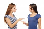 stock photo of argument  - Two girls friends standing on white background and having an argument - JPG