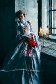 foto of lonely woman  - Woman in victorian dress imprisoned in a dungeon - JPG