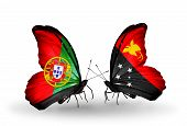 pic of papua new guinea  - Two butterflies with flags on wings as symbol of relations Portugal and Papua New Guinea - JPG