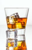 pic of whiskey  - Glass of whiskey with ice isolated on white background - JPG