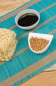 image of condiment  - A buch of Chow Mein noodles and bowls with condiments - JPG