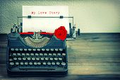 stock photo of rose flower  - Vintage typewriter with white paper and red rose flower - JPG
