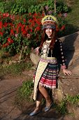 stock photo of hmong  - Traditionally dressed Mhong hill tribe woman in the garden at mountain
