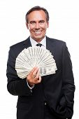 foto of only mature adults  - Waist up of confident mature man in formalwear holding money and smiling while standing against white background - JPG