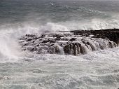 picture of wrecking  - dangerous rock covered by the waves of the sea where ships can wrecked - JPG
