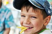 Boy Eating French Fries
