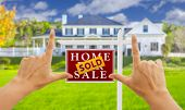 stock photo of framing a building  - Female Hands Framing Sold Home For Sale Real Estate Sign in Front of New House - JPG