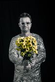 pic of spaceman  - Portrait of a happy spaceman holding flowers - JPG
