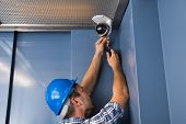 image of cctv  - Photo Of Professional Cctv Technician Adjusting Cctv Camera