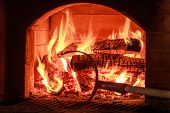 picture of furnace  - Burning firewood in a traditional hearth furnace - JPG