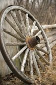 foto of wagon wheel  - Old rustic wagon wheel that has been weathered by age and elements - JPG