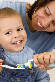 picture of mother child  - Woman and young boy prepare the toothbrush - JPG