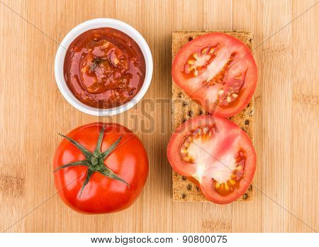 Wheat Crisp Bread, Bowl With Ketchup And Tomato On Board