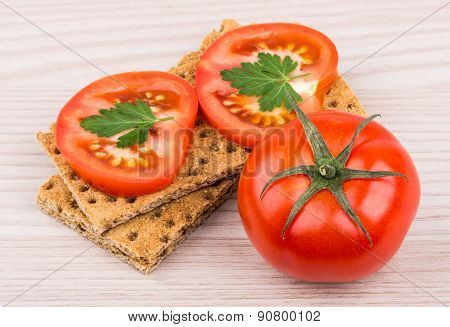 Wheat Crisp Bread And Tomato On Table