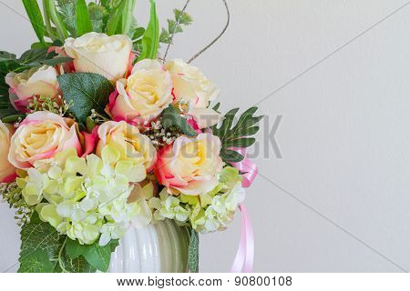 Beautiful Fake Flowers in Whie pot on wood table, cool tone