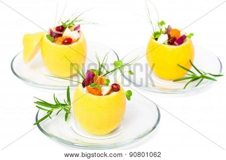 Isolated Stuffed Lemons With Vegetarian Salad