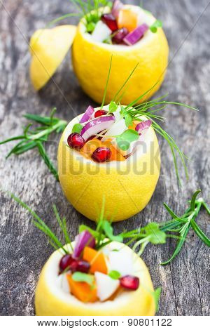 Stuffed Lemons With Vegetarian Salad On The Old Table