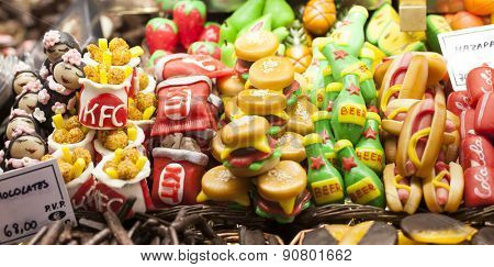 BARCELONA, SPAIN - MAY 4, 2015: Famous La Boqueria market - one of the oldest markets (Established in 1217) in Europe that still exists. Close up of a huge selection of  colorful sweets.