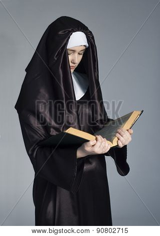 Nun With Bible