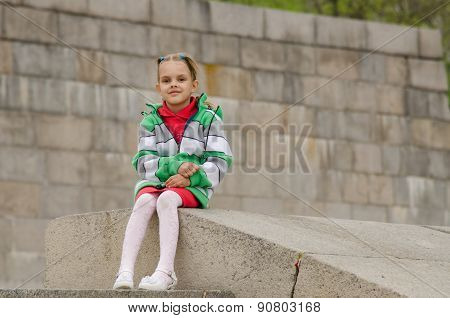 Girl Sitting A Granite Embankment On Ramp