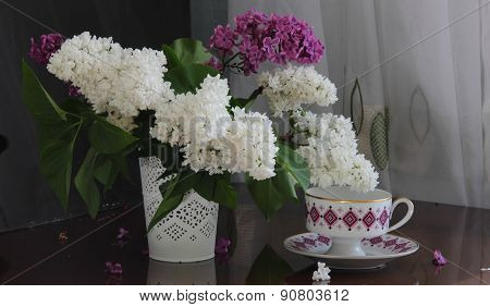 Bouquet Of A Lilac And Tea In A Beautiful Cup