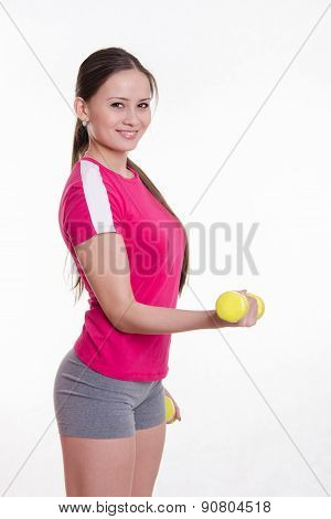Sportswoman With Dumbbells Workout Performs