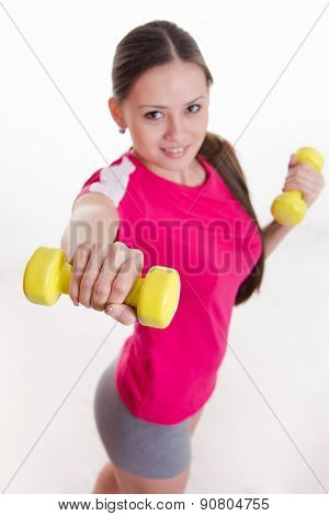 Dumbbells In The Hands Of Athletes