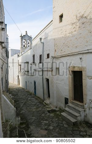 Narrow Alley In The Center Of The Medieval Town Ostuni In Puglia, Italy