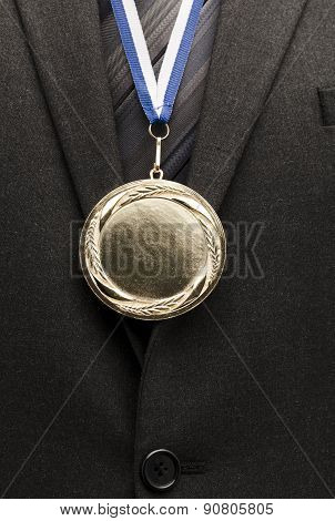 businessman with gold medal