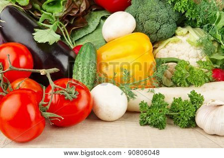 Group Of Different Vegetables On Wooden Board