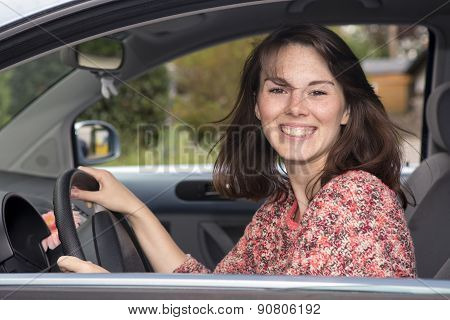 Portrait Of Young Woman Sitting In A Car