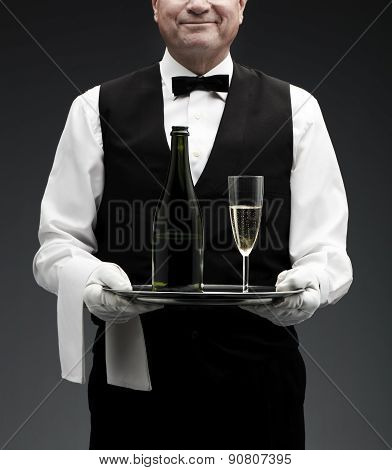 butler with champagne