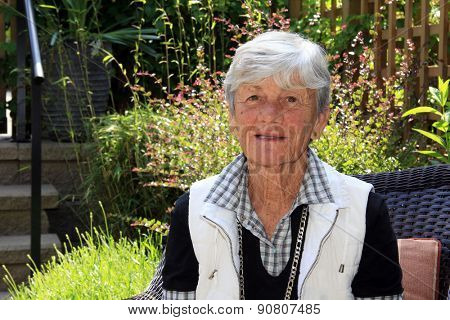 Senior lady age 75, outside in the garden.