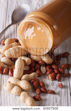 Peanut Butter In A Glass Jar Close Up On The Table Vertical