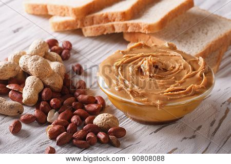 Peanut Butter In A Bowl Close-up And Toast. Horizontal
