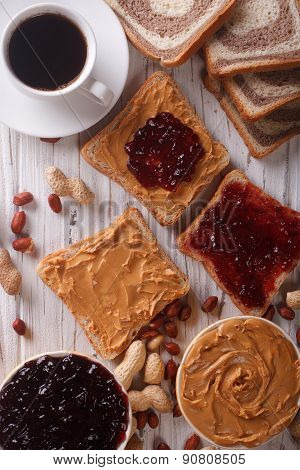 Sandwiches With Jam, Peanut Butter And Coffee Top View