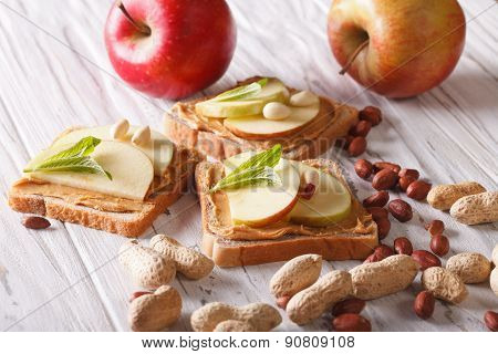 Sandwiches With Peanut Butter And An Apple Horizontal
