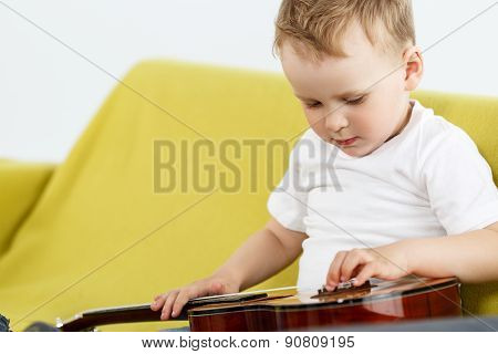 Young Ukulele Player