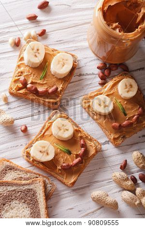 Kids Sandwiches With Peanut Cream And Banana. Top View