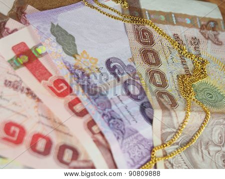 Gold Necklace On Thai Banknotes Money Background