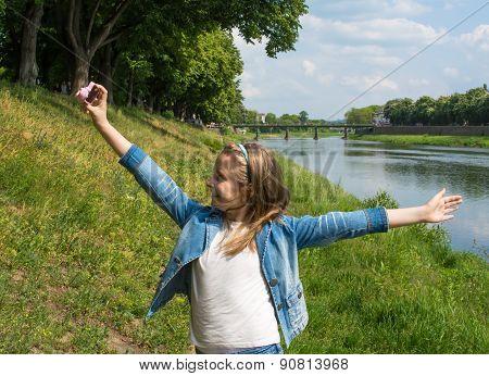 Beautiful Happy Girl Taking A Selfie