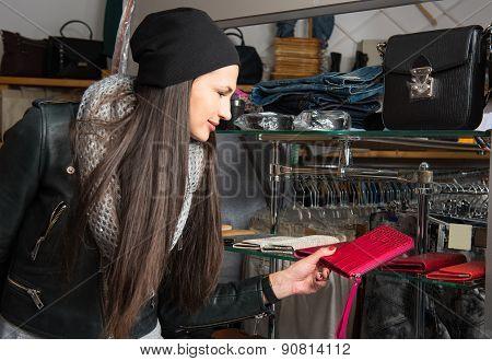 Beautiful Young Woman Choosing Leather Purse