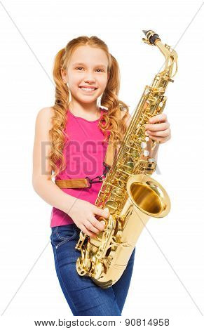 Close-up view of girl playing alto saxophone