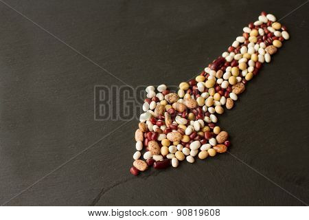 Beans And Peas On A Black Stone