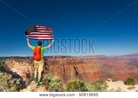Grand Canyon National Park and man with US flag