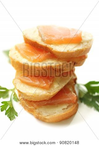 Stack Of Sandwiches With Salted Salmon On A Plate