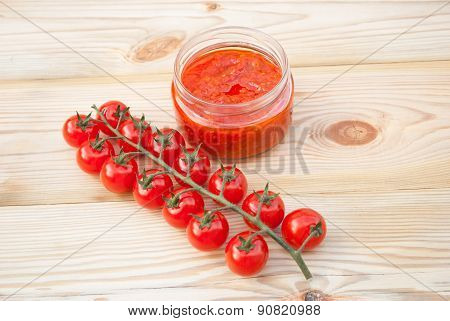 Tomatoes And Tomato Sauce On A Wooden Table.