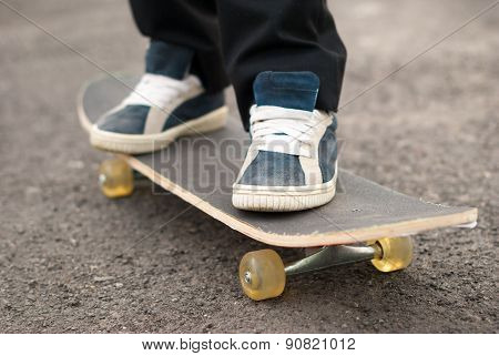 Skateboarder Rides On The Board.