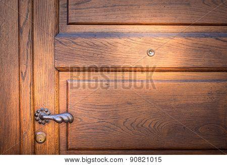 Ancient Door Lock And Textured Wood
