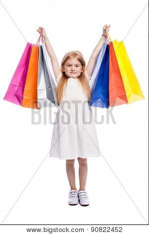 Excited Young Shopper With Big Colourful Shopping Bags.